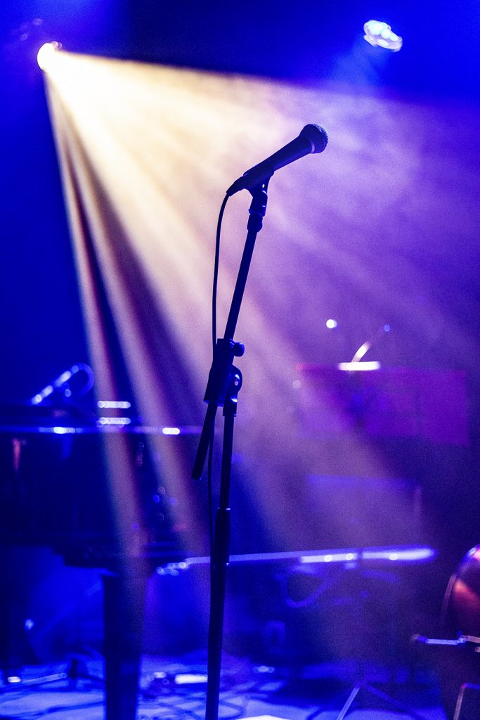 Mic stand in the spotlight waiting for it all to start